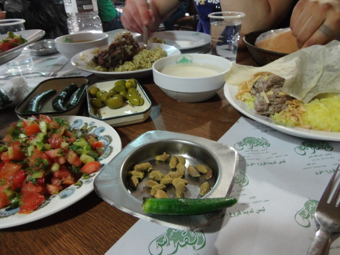 Lamb neck, mansaf, salad and olives at Al-Quds.