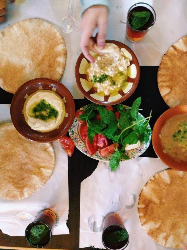 Hommous, pita, falafel and fuul (bean dip), salad at Hashem restaurant.