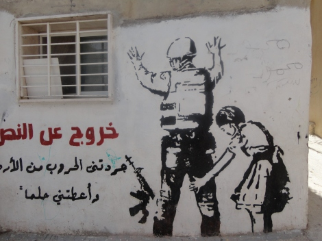 """Arabic graffiti at Deheishe refugee camp, near Bethlehem. Lines from Arab poet Mahmoud Darwish which read, """"The war has taken everything from me, All I have left is my dreams"""