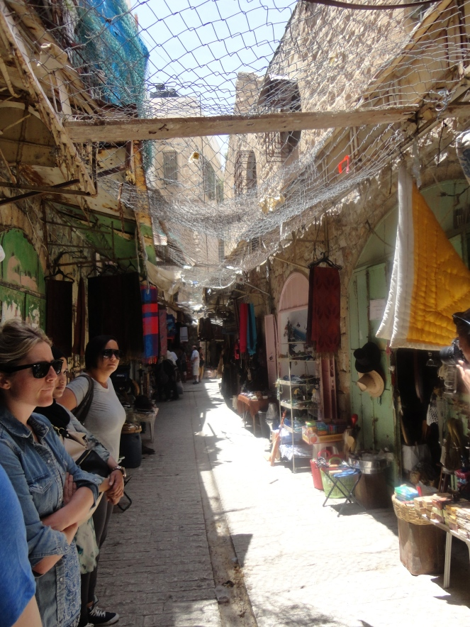 Wire mesh covering Hebron market.