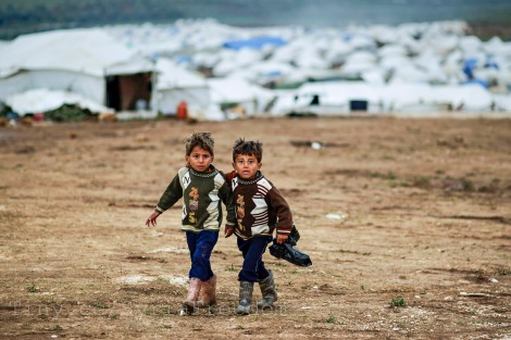 Syrian boys, whose family fled their home in Idlib, walk to their tent, at a camp for displaced Syrians, in the village of Atmeh, Syria. Picture: Flickr/ Freedom House